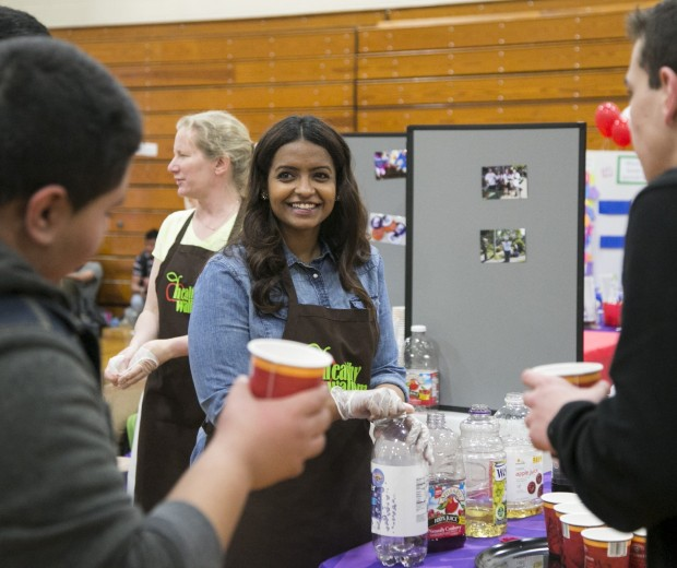 Reem Al-Sukait, Healthy Waltham Intern, teaches WHS students about healthy hydration at the WHS Health Fair.