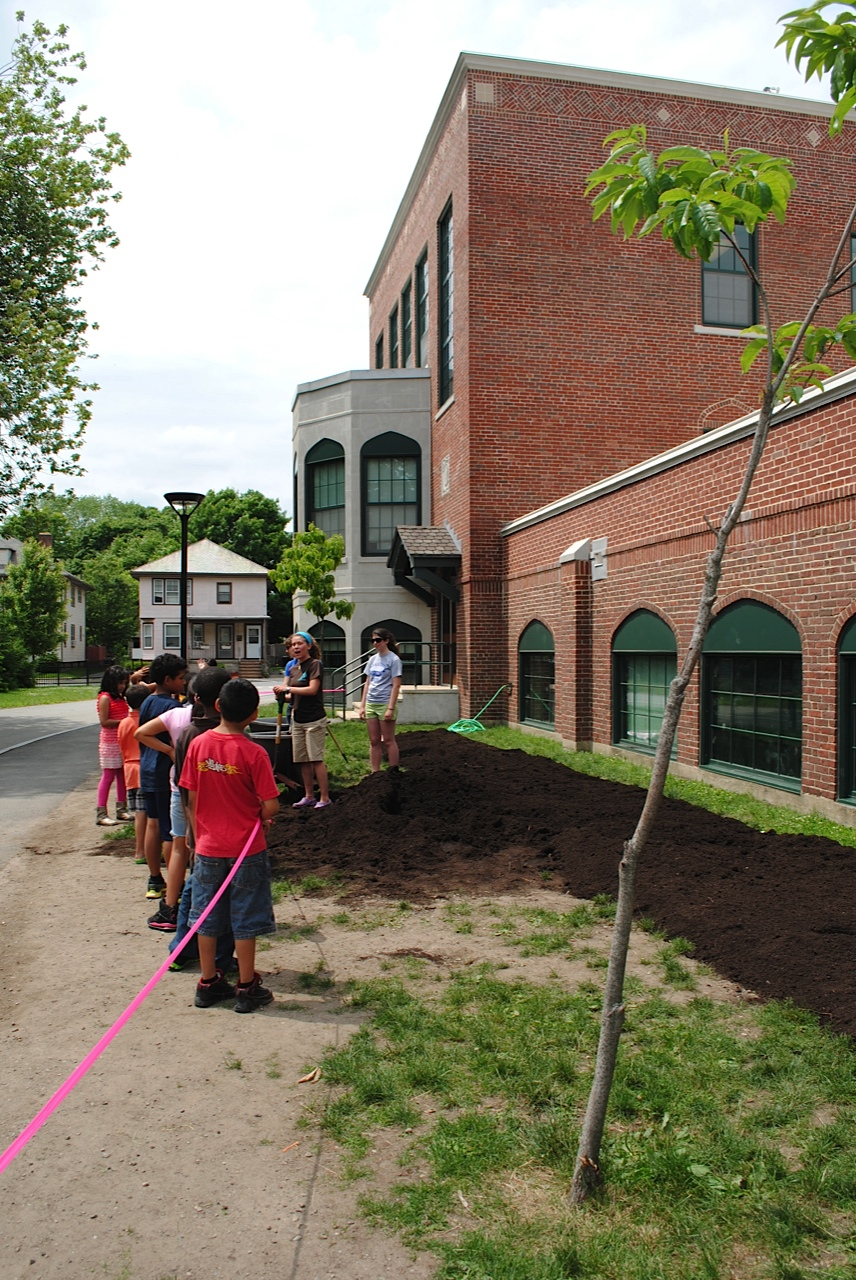 Kids get ready to spread compost at the new Whittemore Elementary School garden.